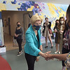 TIM JEAN/Staff photo<br /> <br /> U.S. Senator Elizabeth Warren, center, shakes hands with students and staff at the Lawrence branch of Northern Essex Community College during a visit to the food pantry on campus.   6/1/21