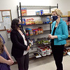 TIM JEAN/Staff photo<br /> <br /> U.S. Senator Elizabeth Warren, center, and Lawrence Mayor, Kendrys Vasquez, right, listen to Janel D'Agata-Lynch, Civic Engagement, Service-Learning and Community Resources Coordinator and student Courtney Morin, left, of Lawrence, in the food pantry of the Lawrence branch of Northern Essex Community College.  6/1/21