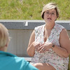 TIM JEAN/Staff photo<br /> <br /> Northern Essex Community College nursing student Tiffany Bell, of Haverhill, talks with with U.S. Senator Elizabeth Warren during a round table discussion outside at the Lawrence campus.   6/1/21