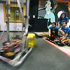 CARL RUSSO/Staff photo. Captains of the Lawrence High School Gearheadz Robotics Team, From left, Pedro Lantiqua, Charvady Hak (standing) Monica Sim and Cristian Welcome give a demonstration using the prototype robot to show what the robot is capable of doing. Using a slow shutter speed from the camera illustrates the speed of the robot. On March 18th.  the Lawrence High school robotics team attended the first Robotics North Shore District Competition in Reading. Along with our two alliance partners, we won the competition for the very first time.  We are in our 14th season and this is a huge accomplishment. Linette Pichardo is the co-advisor for the LHS Robotics Team.  3/27/2018