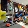 CARL RUSSO/Staff photo. Captains of the Lawrence High School Gearheadz Robotics Team, From left, Pedro Lantiqua, Charvady Hak, Cristian Welcome and Monica Sim give a demonstration using the prototype robot to show what the robot is capable of doing. Using a slow shutter speed from the camera illustrates the speed of the robot's arms for lifting objects. On March 18th.  the Lawrence High school robotics team attended the first Robotics North Shore District Competition in Reading. Along with our two alliance partners, we won the competition for the very first time.  We are in our 14th season and this is a huge accomplishment. Linette Pichardo is the co-advisor for the LHS Robotics Team.  3/27/2018