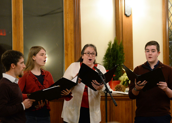 CARL RUSSO/Staff photo. From Left,  Andrew French, (Assistant Pastor) and Heather Lobley, both of Derry N.H., Katie Roe of Manchester N.H. and Caleb Fagan of Derry N.H. perform during the Christmas Eve Carol Sing, sponsored by the Heritage Baptist Church in Windham and held at the historic Searles School and Chapel. <br /> <br /> Around 125 members of the church and guest enjoyed singing or just listening to the traditional Christmas carols. 12/24/2019