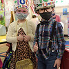 TIM JEAN/Staff photo<br /> <br /> Ellie McCrave, left, and Logan Vien, both pre-kindergarten students display there 100 year old attire as they celebrate 100 days of being in school at Sacred Hearts Early Childhood Education Center. Students at the ECC dressed as though they were 100 years old and took part in 100th day activities to celebrate 100 days of being in school.    3/2/21