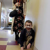 TIM JEAN/Staff photo<br /> <br /> Kindergarten aide Danielle Cavallaro assists student Jacob Tagliaferro as he places footprints down on the floor as they celebrate 100 days of being in school at Sacred Hearts Early Childhood Education Center. Students at the ECC dressed as though they were 100 years old and took part in 100th day activities to celebrate 100 days of being in school.    3/2/21