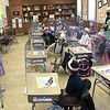 TIM JEAN/Staff photo<br /> <br /> Principal Susan Downer, left, dressed as granny Downer, visits Mrs. Skolski's kindergarten classroom as they celebrate 100 days of being in school at Sacred Hearts Early Childhood Education Center. Students at the ECC dressed as though they were 100 years old and took part in 100th day activities to celebrate 100 days of being in school.    3/2/21