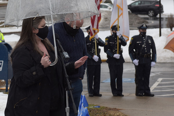 TIM JEAN/Staff photo<br /> <br /> Methuen Councilor Jessica Finocchiaro speaks during a Covid-19 victims memorial ceremony outside the Quinn Public Safety Building. The event included the Methuen Police Honor Guard, Methuen Fire Department a moment of silence, and a symbolic 71 bell tolls to represent the lives lost.  3/1/21