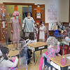 TIM JEAN/Staff photo<br /> <br /> Principal Susan Downer, left, dressed as granny Downer, and Chrissie Pettis, Director of the Early Childhood Education Center visit a kindergarten classroom as they celebrate 100 days of being in school at Sacred Hearts Early Childhood Education Center. Students at the ECC dressed as though they were 100 years old and took part in 100th day activities to celebrate 100 days of being in school.    3/2/21
