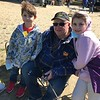 Dan Love , center , enjoyed some  fishing with grandchildren Parker Bartrum ,7, and sister Kieran,10, during Saturday's fishing derby in Derry