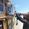 TIM JEAN/Staff photo<br /> <br /> At right, Gabby Lajoie, 14, of Derry, receives a rainbow flavored shaved cup from the Kona Ice co-owner Tina Dibona, left, in the Food Truck Festival area on Manning St., during Derby Day in downtown Derry, NH.   5/1/21