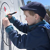 TIM JEAN/Staff photo<br /> <br /> Costas Keanf, 5, of Derry, paints an outer space theme in a bubble thats part of the Alan Shepard Mural along the Rail Trail/ South Ave., during Derby Day in downtown Derry, NH.   5/1/21