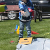 TIM JEAN/Staff photo<br /> <br /> Mason Hager, 5, of Salem, NH., plays a game in the pop-up family activity area along Broadway during Derby Day in downtown Derry, NH.   5/1/21