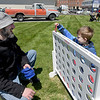 TIM JEAN/Staff photo<br /> <br /> Max Hager, left, of Salem, NH., plays a game with his son Mason, 5, in the pop-up family activity area along Broadway during Derby Day in downtown Derry, NH.   5/1/21