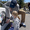 TIM JEAN/Staff photo<br /> <br /> Norah Murphy, 6, of Derry, and her father Ryan paint an outer space theme in a bubble thats part of the Alan Shepard Mural along the Rail Trail/ South Ave., during Derby Day in downtown Derry, NH.   5/1/21