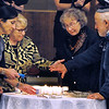 CARL RUSSO/Staff photo. From left, Members of the Temple Emanuel Congregation, Rachel Perlitsh of Andover, Roberta Braverman of North Andover and Rachel's parents, Hilda and Max Perlitsh of Winchester light six candles in memory of the six million Jews who died at the hands of the Nazis, five candles in memory of other victims and a twelfth candle for people around the world. Temple Emanuel of Andover held their annual Kristallnacht-Holocaust remembrance service Thursday night. The event ''Shattered Glass, Shattered Lives'', was sponsored by the temple and the Center for the Study of Jewish, Christian and Muslim Relations at Merrimack College. Kristallnacht or Crystal Night, is the night of terror when the Nazis  killed at least 91 Jews in Germany on Nov. 9 and 10 in 1938. and burned synagogues and Jewish businesses. 11/08/2018