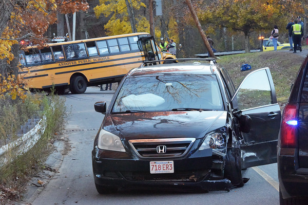 TIM JEAN/Staff photo<br /> <br /> A school bus carrying about 20 Andover High School students was involved in an accident on Red Spring Road with this Honda Odyssey, Thursday afternoon. No one was injured.    11/8/18