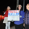 CARL RUSSO/staff photo. From left, Gay Main of Amesbury, Chere Bemelmans of Bradford and Demet Haksever of Haverhill protest at the intersection of Merrimack and Water Streets and Main in Haverhill Thursday night. The protesters are concerned with the possibility that Trump could interfere with the Russia investigation lead by Special Counsel Robert Mueller. 11/08/2018