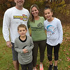 TIM JEAN/Staff photo<br /> <br /> Jon and Becki O'Sullivan with their children Maeve, 10, and Finn, 7, of Atkinson., NH., where a different t-shirt they received from running the annual Feaster Five Thanksgiving Day road race. They met at the Feaster Five in 2001, later got married and run the race every year since.   11/9/18