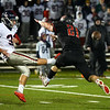 CARL RUSSO/Staff photo North Andover's Mike Roche blocks this punt by Lincoln-Sudbury's Joey Caloiero. North Andover defeated Lincoln-Sudbury 42-0 in D2 North final football action. 11/09/2018