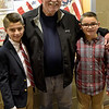 TIM JEAN/Staff photo<br /> <br /> Tom Trombly, a US Army veteran stands with his grandsons Kyle, 11, left, and Kory, 9, all of North Andover at the Pvt. Albert E. Thomson Elementary School. The school is named in honor of Pvt. Albert E. Thomson, who was killed in World War I on Nov. 9, 1918, 100 years ago this day.  11/9/18