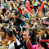 "TIM JEAN/Staff photo<br /> <br /> Students wave flags while singing ""You're a grand Old Flag"" at the conclusion of a Salute to Veterans program at the Pvt. Albert E. Thomson Elementary School. The school is named in honor of Pvt. Albert E. Thomson, who was killed in World War I on Nov. 9, 1918, 100 years ago this day.  11/9/18"