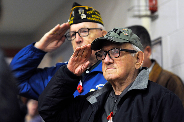 """TIM JEAN/Staff photo<br /> <br /> Veterans Leonard Enaire, right, and Robert Gauthier salute during """"Taps"""" at the Salute to Veterans program at the Pvt. Albert E. Thomson Elementary School. The school is named in honor of Pvt. Albert E. Thomson, who was killed in World War I on Nov. 9, 1918, 100 years ago this day.  11/9/18"""