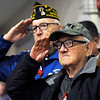"TIM JEAN/Staff photo<br /> <br /> Veterans Leonard Enaire, right, and Robert Gauthier salute during ""Taps"" at the Salute to Veterans program at the Pvt. Albert E. Thomson Elementary School. The school is named in honor of Pvt. Albert E. Thomson, who was killed in World War I on Nov. 9, 1918, 100 years ago this day.  11/9/18"