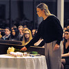 CARL RUSSO/Staff photo. A Merrimack College student adds a white rose to the table of candles to symbolize people who have suffered or continue to suffer persecution. Temple Emanuel of Andover held their annual Kristallnacht-Holocuast remembrance service Thursday night. The event ''Shattered Glass, Shattered Lives'', was sponsored by the temple and the Center for the Study of Jewish, Christian and Muslim Relations at Merrimack College. Kristallnacht or Crystal Night, is the night of terror when the Nazis  killed at least 91 Jews in Germany on Nov. 9 and 10 in 1938. and burned synagogues and Jewish businesses. 11/08/2018