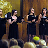 CARL RUSSO/Staff photo. Members of the Merrimack College Concert Choir, from left, freshmen, Sarah Dobbin and Sarah Scougall; junior, Sara Tarascio and freshman, Taite Beale perform a meditation song during the  lighting of six candles in memory of the six million Jews who died at the hands of the Nazis, five candles in memory of other victims and a twelfth candle for people around the world. Temple Emanuel of Andover held their annual Kristallnacht-Holocaust remembrance service Thursday night. The event ''Shattered Glass, Shattered Lives'', was sponsored by the temple and the Center for the Study of Jewish, Christian and Muslim Relations at Merrimack College. Kristallnacht or Crystal Night, is the night of terror when the Nazis  killed at least 91 Jews in Germany on Nov. 9 and 10 in 1938. and burned synagogues and Jewish businesses. 11/08/2018