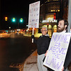 CARL RUSSO/staff photo. From left, Michael Alicca and Robert Wasik, both of Salem N.H. protest at the intersection of Merrimack and Main Street in Haverhill Thursday night. The protesters are concerned with the possibility that Trump could interfere with the Russia investigation lead by Special Counsel Robert Mueller. 11/08/2018	 <br />  11/08/2018