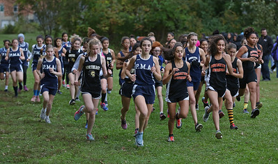 MIKE SPRINGER/Staff photo Runners leave the starting line in the girls race during a varsity cross country meet Wednesday at Greater Lawrence Technical School. 10/16/2018