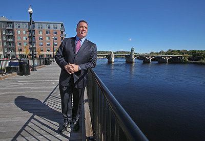 MIKE SPRINGER/Staff photo Developer Sal Lupoli looks out over the Merrimack River from the boardwalk in downtown Haverhill, near the place where his new riverside high-rise, The Heights, is under construction. 10/18/2018