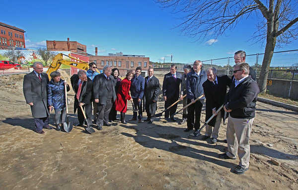 MIKE SPRINGER/Staff photo Government and business leaders hold a ground-breaking ceremony Thursday at the site of a new high-rise, The Hights, along the Merrimack River in Haverhill. 10/18/2018