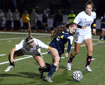 CARL RUSSO/Staff photo Andover's Rachel Souza and Haverhill captain, Kylee Murphy fight for the ball in soccer action. The game ended in a 1-1 tie. 10/16/2018