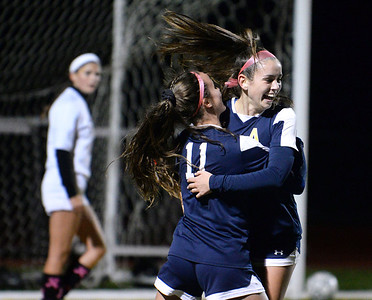 CARL RUSSO/Staff photo Andover's Hope Joel, 11, celebrates with Julianna Kennedy after Kennedy scored a goal late in the first half to tie the game 1-1 in soccer action against Haverhill. The game ended in a tie. 10/16/2018