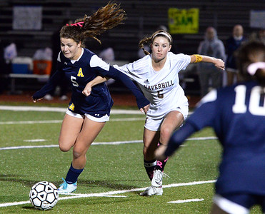 CARL RUSSO/Staff photo Andover's Caroline Ross and Haverhill captain, Kylee Murphy fight for the ball in soccer action. The game ended in a 1-1 tie. 10/16/2018