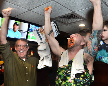 CARL RUSSO/Staff photo First time contestant, Mitch Janusz of Salem celebrates with his friend David Applebee as he wins the 6th annual Hot Wings Eating Contest held at the 99 Restaurant in Salem Wednesday night. All proceeds go to the Greater Salem Boys and Girls Club. First person to eat 35 wings wins  $100 Visa gift card. 10/17/2018