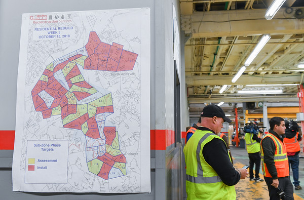 AMANDA SABGA/Staff photo   A map outlining areas being worked on is seen at a Gilbane Reconstruction Services warehouse in Lawrence.   10/18/18
