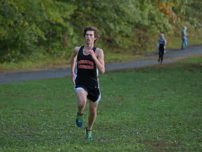 MIKE SPRINGER/Staff photo Edward Adams of Greater Lawrence Technical School runs to victory during a varsity cross country meet Wednesday in Lawrence. 10/16/2018