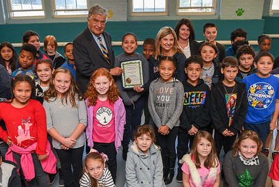 AMANDA SABGA/Staff photo   Haverhill Mayor James Fiorentini presents the Mayor's Excellence in Education to the Tilton Elementary School Principal Bonnie Antkowiak for the school's outstanding performance on the 2018 MCAS test. In center from left, Mayor James Fiorentini, Principal Bonnie Antkowiak and Superintendent Margaret Marotta   10/18/18