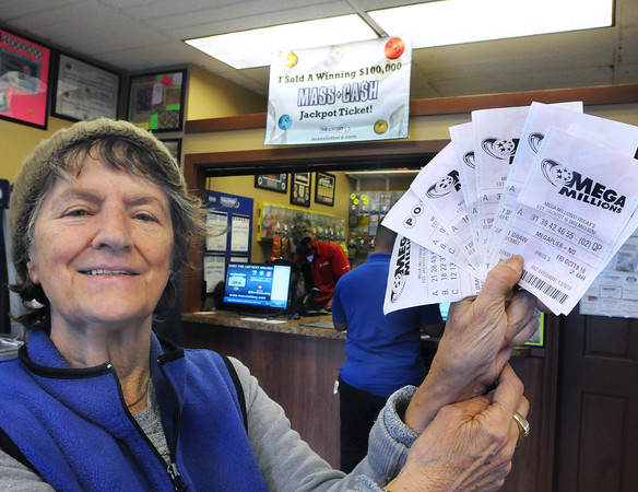 CARL RUSSO/Staff photo Celia Monty of South Lawrence holds up her lottery tickets and hopes her luck changes after dealing with the gas explosion crisis. People from all over line up at Ted's State Line Mobil in Methuen to buy Mega Millions tickets because of the large jackpot.10/18/2018