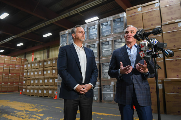 AMANDA SABGA/Staff photo   NiSource Chief Restoration Officer Pablo Vegas and Chief Recovery Officer Joe Albanese, appointed by Massachusetts Governor Charlie Baker speak to the press at a Gilbane Reconstruction Services warehouse in Lawrence.   10/18/18