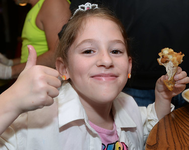 CARL RUSSO/Staff photo The youngest contestant, Alexis Barnes, 8 of Methuen prefers plain wings as she competes in the 6th annual Hot Wings Eating Contest held at the 99 Restaurant in Salem Wednesday night. She raised $110.00 for the club by herself  and just over $400.00 with a little help just before the event started. All proceeds go to the Greater Salem Boys and Girls Club. First person to eat 35 wings wins  $100 Visa gift card. 10/17/2018