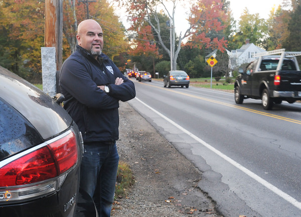 CARL RUSSO/staff photo. Mo Morrill of Plaistow stands at the edge of his driveway on North Ave. Several residents are upset because people already cut through North Ave. to get to 495. Traffic backs up to the point that Mo can't get out of his own driveway.10/17/2018