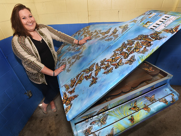 Sarah Tomkins, art teacher at North Andover middle school, painted a piano with butterflies,