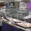 A student picks out items to eat in the lunchroom at Londonderry High School. Londonderry is getting creative and making more than ever from scratch, simply out of necessity because of the supply issues across the region.  10/12/21