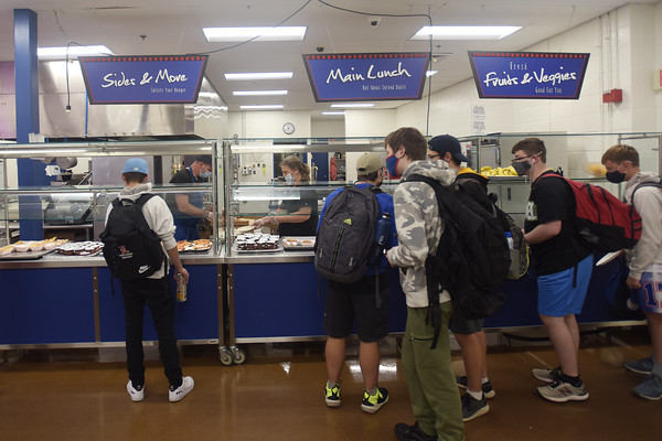 Students pick out items in the lunchroom at Londonderry High School. Londonderry is getting creative and making more than ever from scratch, simply out of necessity because of the supply issues across the region.  10/12/21