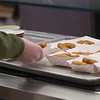 A student pick out items to eat in the lunchroom at Londonderry High School. Londonderry is getting creative and making more than ever from scratch, simply out of necessity because of the supply issues across the region.  10/12/21