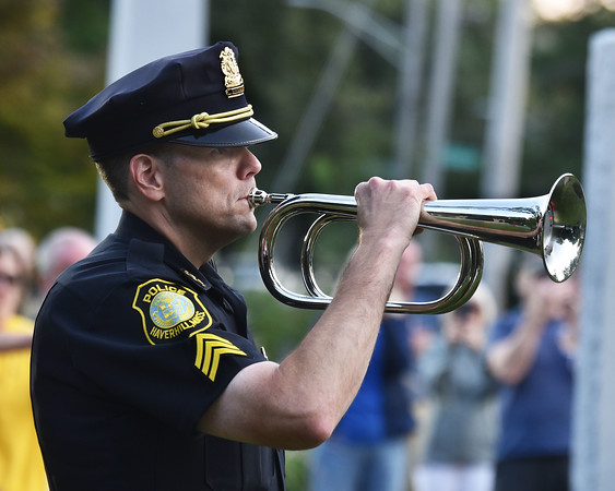 CARL RUSSO/Staff photo Haverhill police Sgt. Kevin Lynch, a Navy veteran and 25 years on the force, plays taps during the ceremony. Haverhill's Vietnam Memorial Commission held the formal dedication of the Vietnam Veterans' Memorial at Millbrook Park on Saturday night, September 11. <br /> <br /> The Commission members chose this day to honor Vietnam veterans and those who died in the war, to recognize the 13 members of the military who were killed in Afghanistan recently, and to remember those who perished in the 911 terrorist attacks.<br /> 9/11/2021