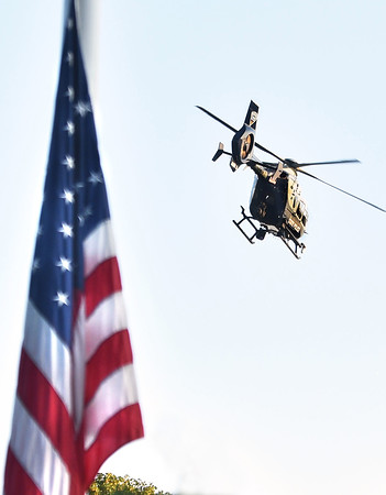 CARL RUSSO/Staff photo The Massachusetts State Police Air Wing opened the ceremony with a fly-over the Vietnam Veterans' Memorial. Haverhill's Vietnam Memorial Commission held the formal dedication of the Vietnam Veterans' Memorial at Millbrook Park on Saturday night, September 11. <br /> <br /> The Commission members chose this day to honor Vietnam veterans and those who died in the war, to recognize the 13 members of the military who were killed in Afghanistan recently, and to remember those who perished in the 911 terrorist attacks.<br /> 9/11/2021