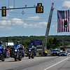 TIM JEAN/Staff photo<br /> <br /> State Police motorcycles escort the procession as thousands of people lined Winthrop Avenue in Lawrence to show support as the body of USMC Sergeant Johanny Rosario Pichardo's was returned to the City for her funeral. The procession was lead by State Police and passed under a giant flag hoisted above the roadway by two of Lawrence Fire's ladder trucks.     9/11/21
